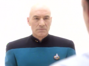 Picard in a blue uniform with low rank
